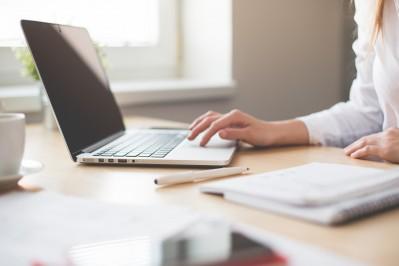 business-woman-working-on-laptop-in-her-office-picjumbo-com.jpg